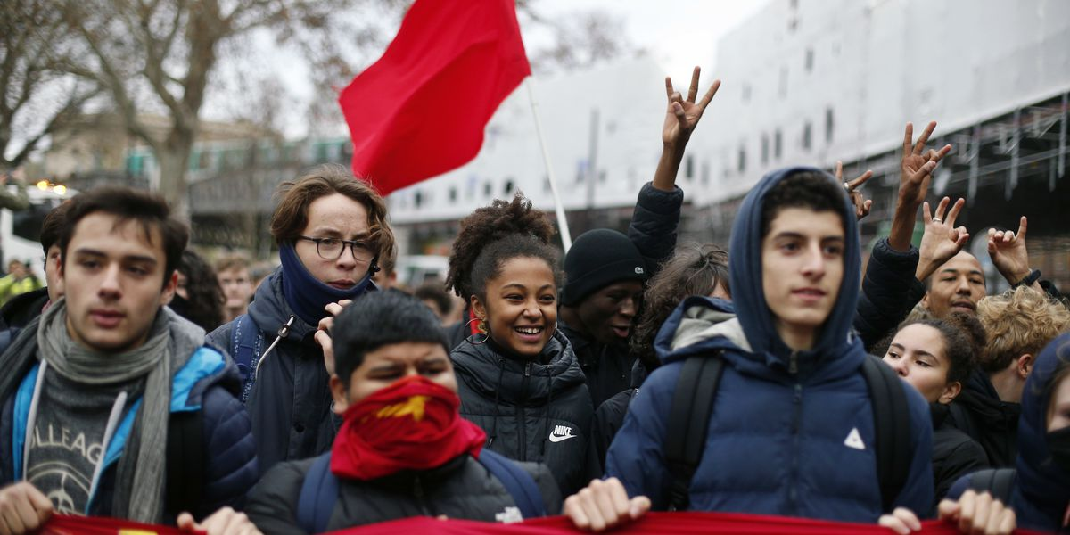 The Latest: Protests underway on Champs-Elysees